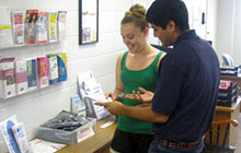 Students look through wellness pamphlets.