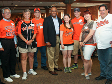 President Schmoke greets UB alumni at a Baltimore Orioles game