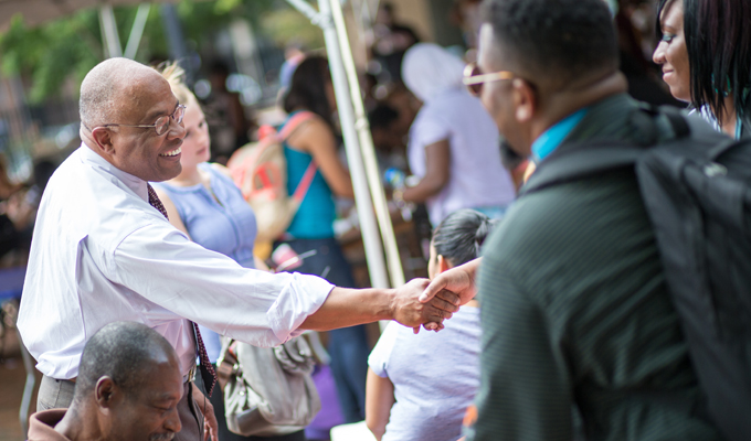 President Schmoke greets students during Welcome Weeks 2014