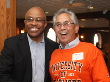 President Schmoke enjoys a laugh with a UB alumnus at a recent O's game
