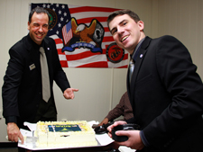 two military students cutting the Military Veterans of the University of Baltimore cake