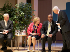 UB's new president, Kurt Schmoke (seated, right), prepares to meet the UB community