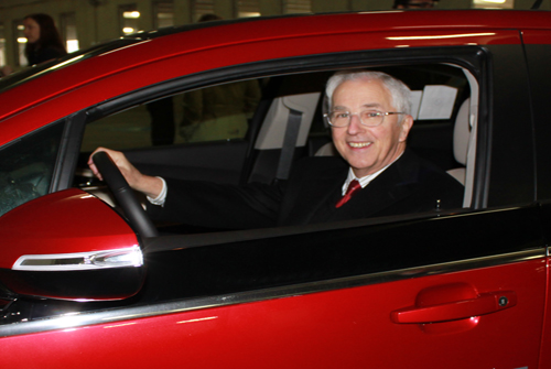 Pres. Bogomolny checks out a Chevrolet Volt EV during the March 31, 2011 debut of new charging stations in the Fitzgerald at UB Midtown.