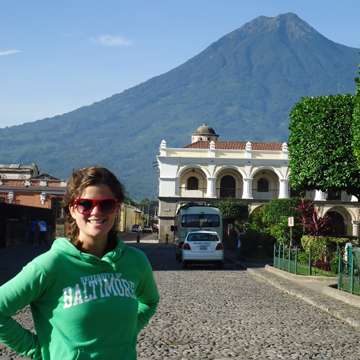 Amanda Grant in Antigua with one of three area volcanoes in the distance