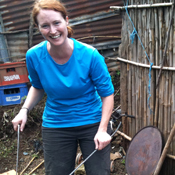 Kelly McPhee cutting reinforcement steel for a stove during her 2011 trip