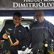 selling olive oil at Baltimore Farmers Market