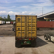 shipping truck transporting olive oil