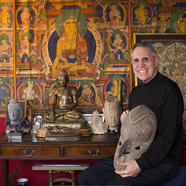 Richard Trotter sits with a selection of artifacts