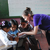 Nikonorova helping students read