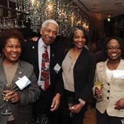 Jessie Lyons Crawford; J. Randall Carroll; Joan Davenport, B.A. '80, J.D. '95; and Kim D. Parker, J.D. '93