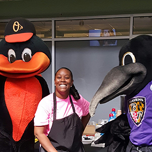 Robin Holmes and the O's and Ravens mascots