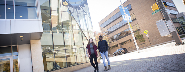 Two University of Baltimore students walking on our urban campus in the city.
