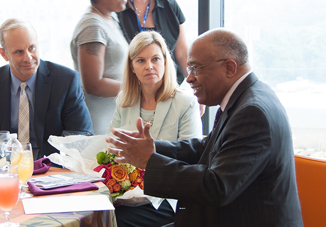 President Schmoke talks with UB faculty and friends