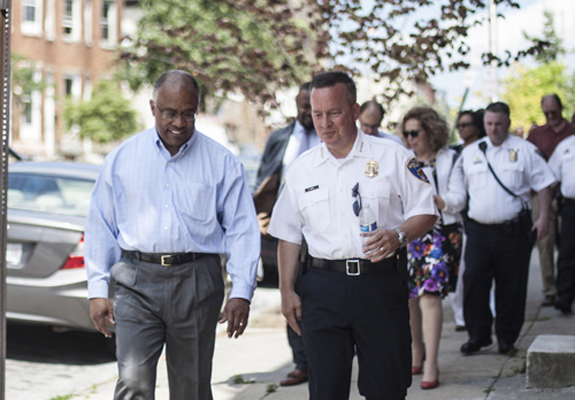President Schmoke walks with Baltimore City Police Commissioner Kevin Davis
