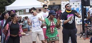 University of Baltimore students enjoying block party