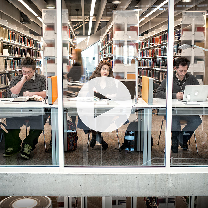 Three students studying in the University of Baltimore Langsdale library
